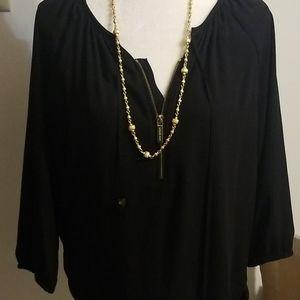 Michael Kors black long sleeve shirt.
